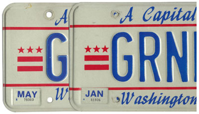 Close-up image of two 1984 base personalized plates in order to show differences in silk-screen printed graphics.