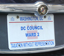 2009 plate marked DC COUNCIL - WARD 2 with a graphic image of the D.C. flag in the background