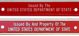 Comparison of U.S. DOS identification legend on early and later embossed 1984 baseplates.