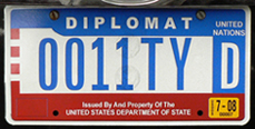 1984 base OFM Diplomat license plate, flat style, no. 0011TYD