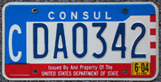 1984 base OFM Consul license plate, late embossed style, no. CDA0302 (assigned to the embassy of Colombia)