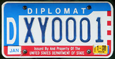 1984 base OFM Diplomat license plate, late embossed style, no. DXY0001