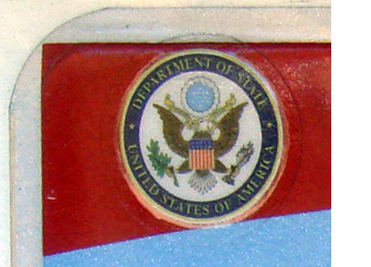 Detail of U.S. Dept. of State seal label on the 2007 OFM base