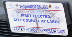 Special plate marked FIRST ELECTED CITY COUNCIL AT LARGE