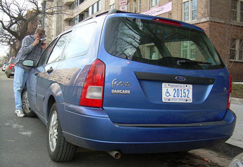 Photographing a windshield sticker near Scott Circle in March 2007