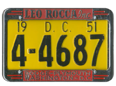 1951 auto plate no. 4-4687 in a chrome advertising frame of Leo Rocca Dodge-Plymouth