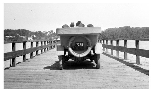 Michigan touring car crossing a wooden bridge in Sept. 1913.