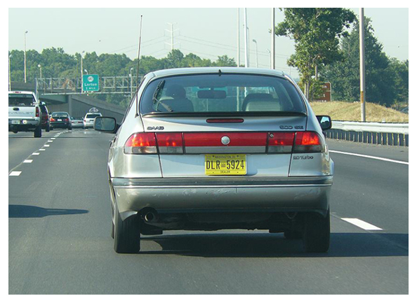 Saab registered with D.C. dealer plate no. 5924 on I-95 in Virginia.