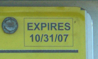 Close-up of expiration date legend on 10-31-2007 D.C. dealer plate.