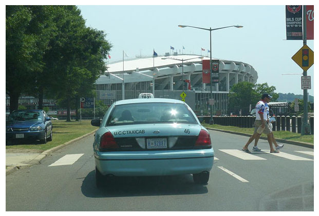 Taxi approaching RFK Stadium eastbound on E. Capitol St.