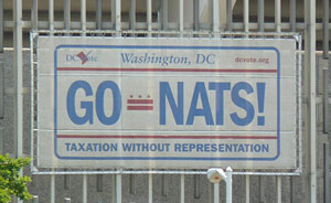 Image of GO-NATS banner in a license plate theme on the side of RFK Stadium
