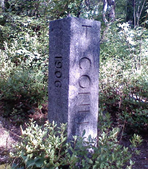 The Conn.-Mass. state line marker alongside the abandoned Conrail line, about one quarter mile north of the Tri-State Marker.