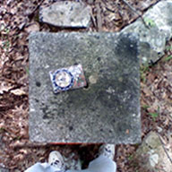 The top of the Connecticut corner marker, with my compass facing north in the Conn. portion.